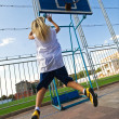 Royalty-Free Stock Photo: Girl playing basketball outside