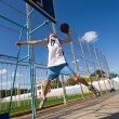 Stock Photo: Basketball player is aiming basket