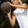 Girl playing basketball outside — Stock Photo