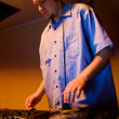 Hip-hop deejay playing vinyl record — Stock Photo