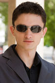 Portrait of young businessman in sunglas — Stock Photo