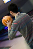 Bowler throwing a ball — Stock Photo