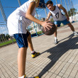 Two young playing basketball — Stock Photo