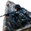 Stock Photo: Soldier with rifle targeting