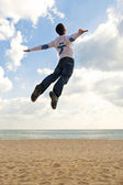 Boy jumping into the sky — Stock Photo