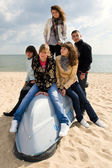 Group of five friends on the boat — Stock Photo