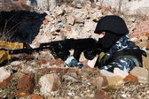 Soldier shooting from covered position — Stock Photo