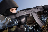 Soldier shooting with automatic rifle — Stock Photo