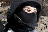 Portrait of armed soldier in helmet — Stock Photo