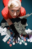 Blond with cash on the poker table — Stock Photo