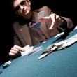 Young poker player - Stock Photo