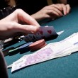 Poker player checking his cards — Stock Photo