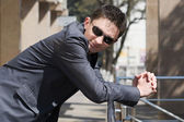 Young businessman in sunglasses — Stock Photo