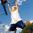 Girl playing basketball outdoors — Stock Photo