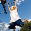 Stock Photo: Girl playing basketball outdoors