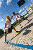 Couple of young playing basketball outside — Stock Photo