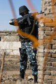 Soldier targeting with automatic rifle — Stock Photo
