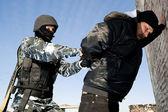 Soldier taking a criminal under arrest — Stock Photo