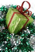 Sparkling gift box and sprangle — Stock Photo