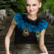 Girl in blouse with peacock feathers posing — Lizenzfreies Foto