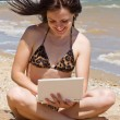 Stock Photo: Smiling girl with notebook at beach