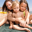 Stock Photo: Young mom with kids at beach resort