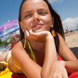 Stock Photo: Little girl sunbathing at the beach
