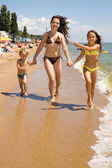 Young mother with kids at the summer resort — Stock Photo