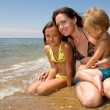 Royalty-Free Stock Photo: Young mom and her kids at the beach