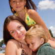 Stock Photo: Young family at the beach