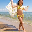 Little girl posing at the seaside — Stock Photo