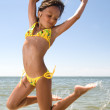Little girl jumping at the sea — Stock Photo