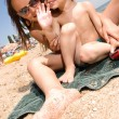 Stock Photo: Two small kids having fun at the beach