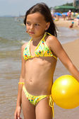 Little girl with a ball at the beach — Stock Photo
