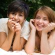 Girls pointing with finger on something smiling — Stock Photo #3491290