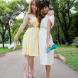Stock Photo: Young girls walking barefoot in park