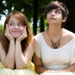 Beautiful girls posing in the park — Stock Photo