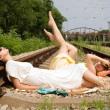 Girls resting on the railroad carelessly — Stock Photo