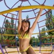 Stock Photo: Little girl at sandy beach playground