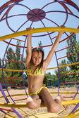 Little girl at the sandy beach playground — Stock Photo