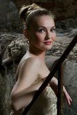 Beautiful young woman posing in the ruins — Stock Photo