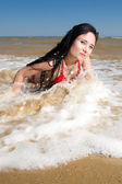 Sexy young adult woman at the sea — Stock Photo