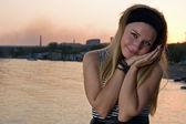 Friendly young girl posing at sea — Stock Photo