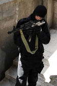 Terrorist with AK-47 automatic rifle — Stock Photo