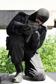 Armed man targeting with AK-47 rifle — Stock Photo