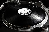Turntable playing vinyl audio record — Stock Photo