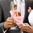 Stock Photo: Bride and groom drinking champagne