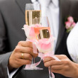 Bride and groom drinking champagne — Stock Photo