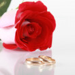 Red rose and wedding ring — Stock Photo #2729208