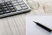 Calculator, notepad and pen — Stock Photo